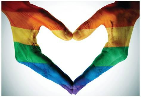 man-hands-painted-as-the-rainbow-flag